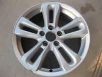 one OEM wheel for a 06 Honda Civiv Si wheel gray in