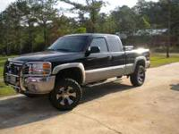 2006 gmc z71 it has a 6 inch fabtech lift new mickey