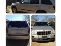07 silver jeep Cherokee Laredo with grey cloth interior