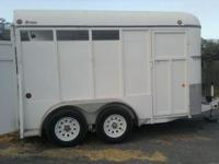 07 morgan 2 horse slant load bp trailer. Has a swinging