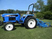 This is an 07 New Holland TC30 with a matching New