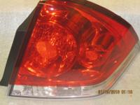 08-12 Chevy Implala passengers side tail light. Factory