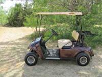 08 ezgo gas golf cart that is Cherry in color, good