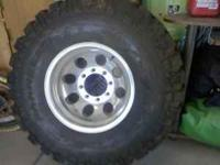 1- 8 lug rim & new tire (35inch).. & 100.00 call