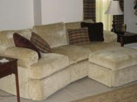 Lazyboy sofa with ottoman in champagne gold withtwo