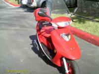 THIS IS A BEAND NEW MOTOR SCOOTER WITH MANY EXTERAS