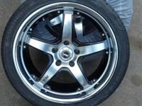 "18"" r-1 racing rims, black and machined with a nice"