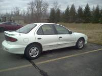 White Pontiac Sunfire sedan, 2.2L 4-cyl automatic