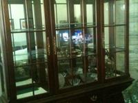 China Cabinet is comprised of two parts. This dramatic