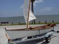 I'm selling this wooden row boat with sail rig. I