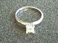 Selling a 1.02ct princess cut diamond engagement ring.