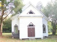 1.1 acre with 100 year old church and out building on