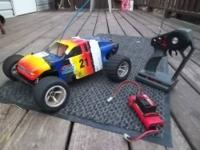 Older nitro rustler but it still moves fast, comes with