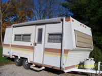 1976 Travel Trailer. In good condition. Will sleep up