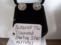 Beautiful brilliant set of diamond halo earrings. 1/2