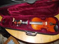 1/2 White Brothers Violin in good condition with case,