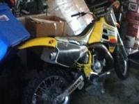 1991 Suzuki RM 125 2 stroke Dirt Bike, has knobby tire
