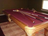 We have a gorgeous FULL SIZE Pool Table with burgundy