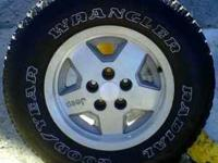 (1) 225/75/15 Goodyear Wrangler Tire Mounted on a Jeep