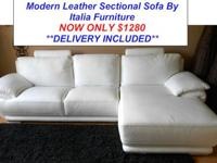 Here is a Stunning Two Piece Cream Leather Sectional