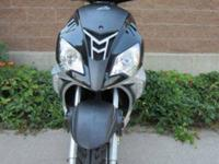 Up for sale is a brand new 2012 Envy scooter. Its a