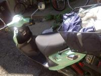 A 2008 Buddy 50cc moped in Seafoam Green. Purchased