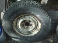ONE --IN EXCELLENT CONDITION -- ON A 5 LUG G.M.C. OR