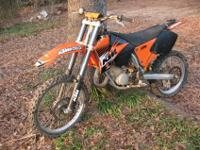 This KTM's an SX, so it's lighter and tougher than the