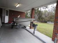 A nice 14' fiberglass boat the gel-coat still holds it
