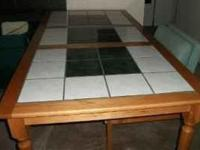 This custom Farmhouse Tile Top Rectangular Dining Table