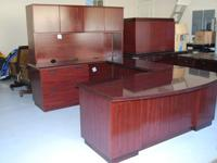 A used Eclipse laminate desk finish classic mahogany