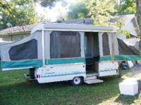 1992 coleman popup camper good condition . One end does
