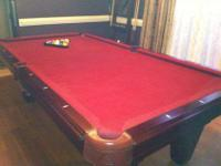 Legacy pool table with matching wall mount cue rack .