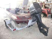 This is a 1986 Winner bass boat, model ZZ880 with a 125