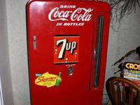 This is a beautiful vintage coke machine that is very