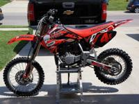 Very clean Honda CR85 with new Dunlop MX31 tires, less