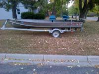 Aluminum fishing boat, motor and trailer for sale.