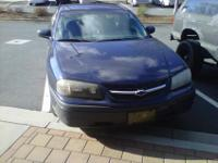2002 Chevy Impala, dark blue, four-door sedan, 3.4L.
