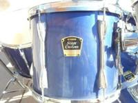 This is a Yamaha Custom Advantage five piece drum set