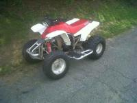 red and white, very fast keeps up with a yamaha warrior