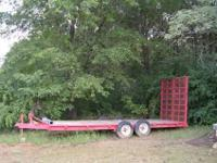 The trailer is 25 ft long overall with 20 ft long deck,