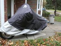 Comes with a Nelson motorcycle cover (as seen in