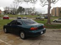 It's a green Chevy Malibu '98. Mileage ~182,000. Car