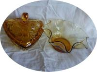 I have for sale 2 light Amber candy dishes. One,