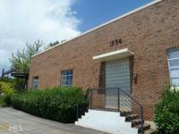 Authentic Candler Park loft! Located in the Warehouse