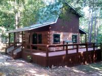 Lake front log home fully furnished and ready for you