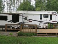 Like new Dutchmen Grand Junction 5th Wheel on one of