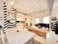 One of a kind 2 story loft living at its best in the