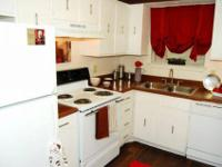 Faux Wood Flooring Throughout (in select apts),