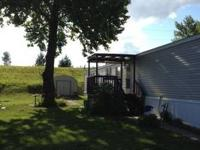 1 bedroom, 1 bath house with fenced yard, carport, work